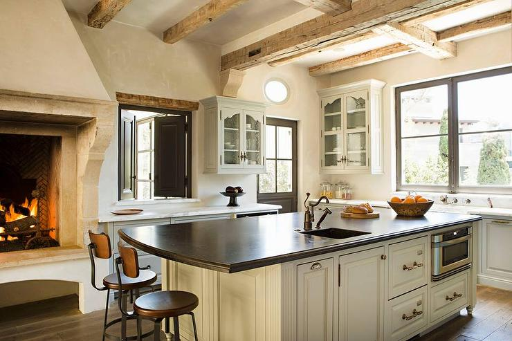 kitchen with rustic fireplace transitional kitchen kitchen fireplace home design ideas pictures remodel and