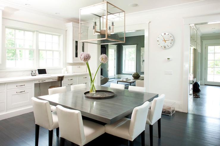 gray square dining table with white dining chairs - transitional