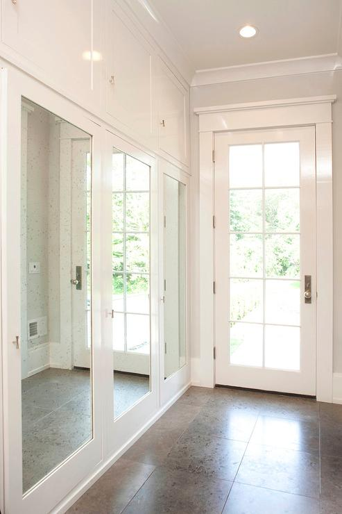 Mudroom With Mirrored Closet Doors Transitional