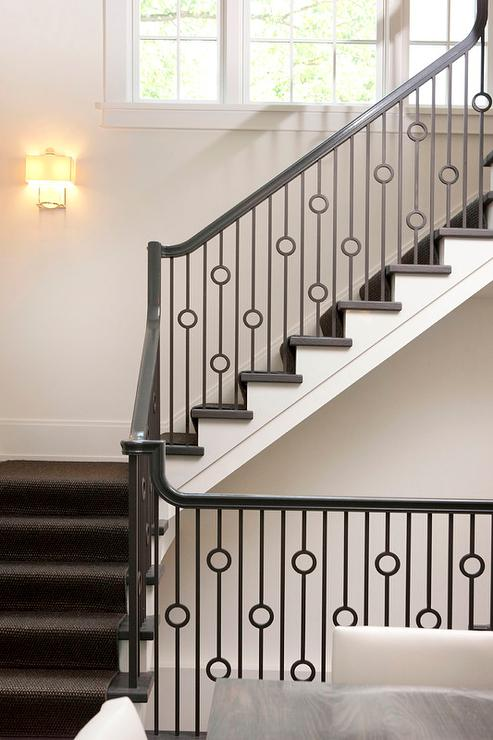 Staircase With Iron Circles Spindles Transitional