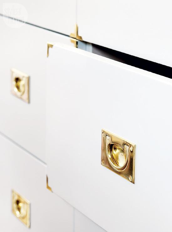 White Cabinets with Gold Campaign Hardware