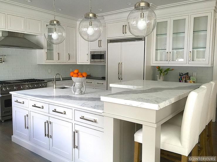 Amazing Kitchen Features Three Clear Glass Globe Pendants Illuminating A  White Center Island Topped With Statuary Marble Fitted With A Small Corner  Prep ...