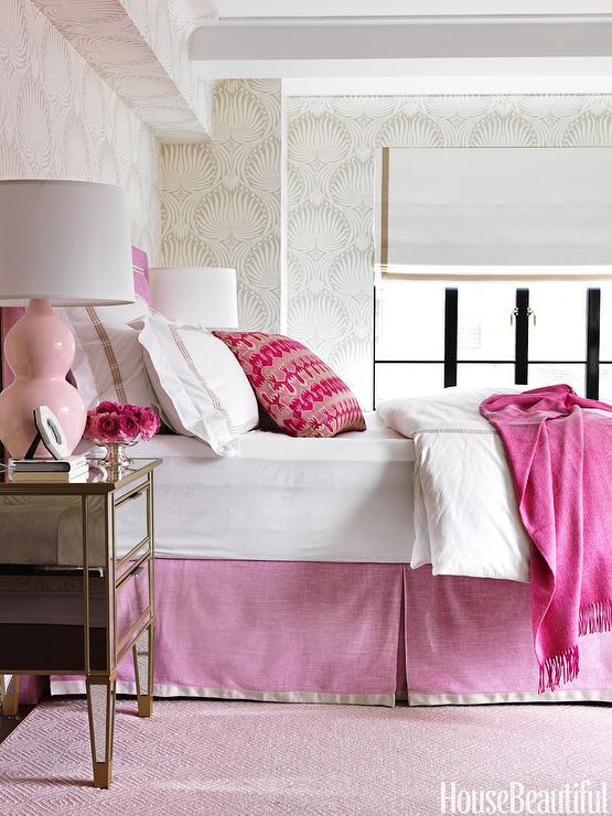 pink headboard and pink bedskirt and pink diamond rug