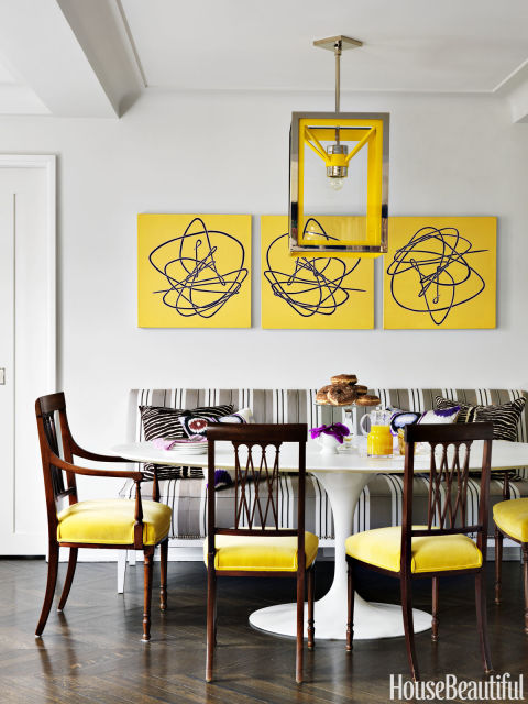 yellow and black dining room with french dining table