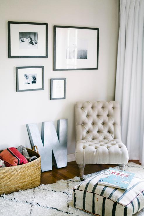 Chic Nursery Features A Black And White Photo Wall Over A Tan Linen Tufted Slipper  Chair, Anthropologie Linen Orianna Slipper Chair, Next To A Zinc Letter ...