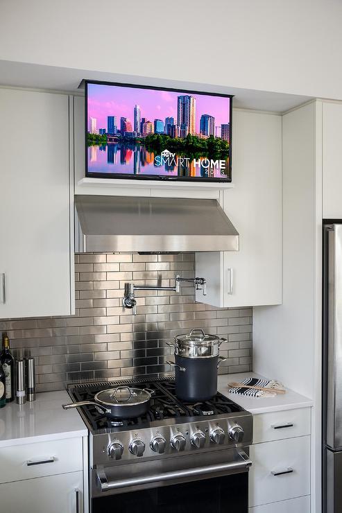 Concealed tv cabinet design ideas for Tv in kitchen design