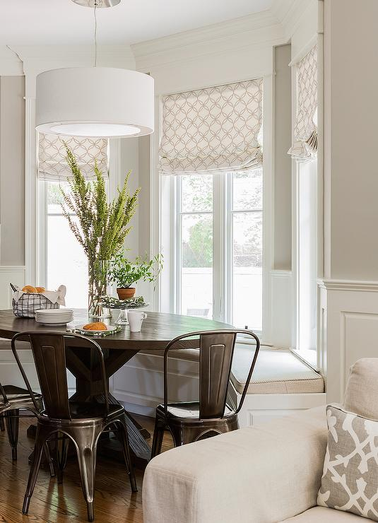 transitional bay window breakfast nook is filled with a bay window