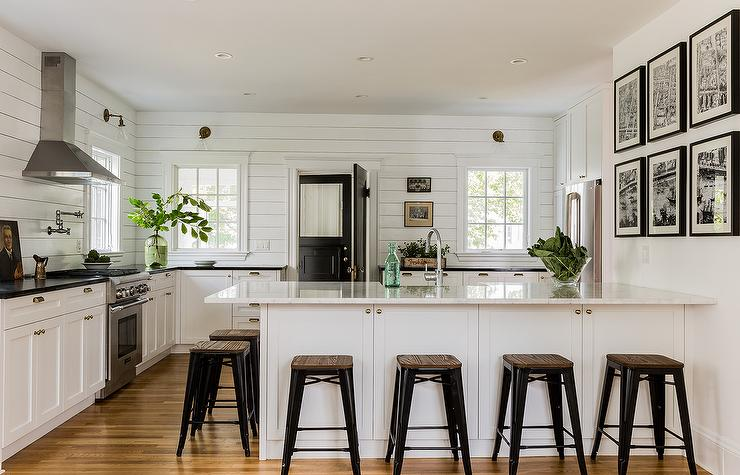 Black And White Cottage Kitchen Features A White Shaker Cabinets