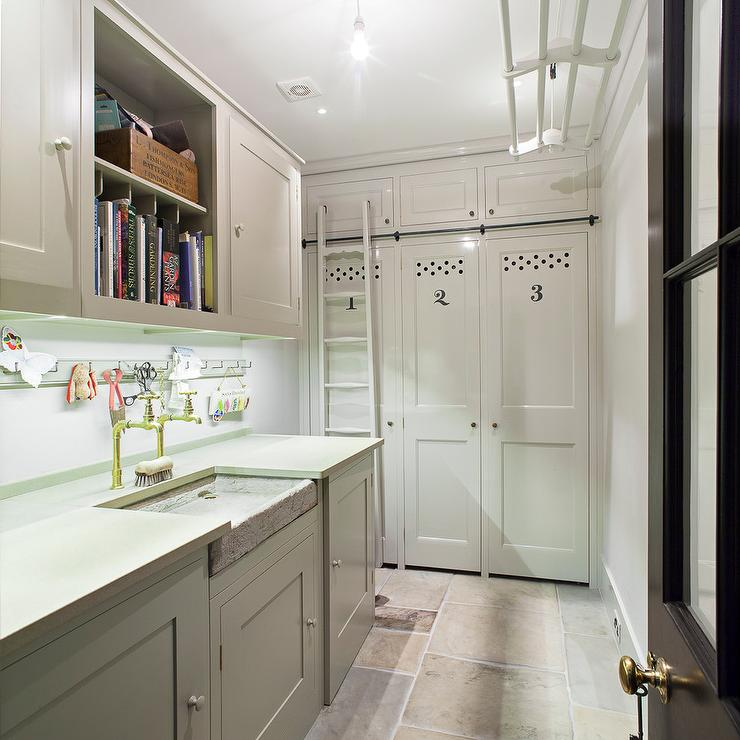laundry room and mudroom combo features gray cabinets paired with gray