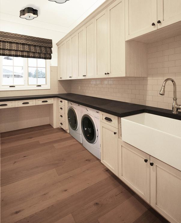Lovely Laundry Room With Cream Cabinets