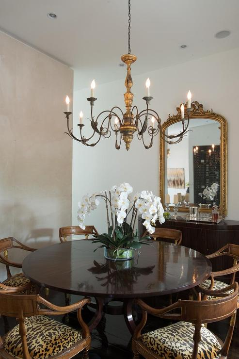 View Full Size Chic French Dining Room Features A Candle Chandelier Illuminating Glossy Round Table