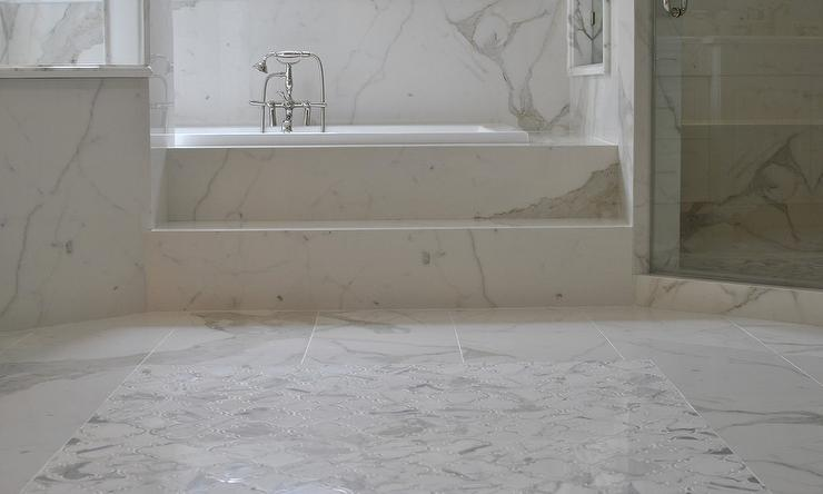 Lovely Spa Like Master Bath Features A White Marble Tiled Floor Accented With  Marble Quatrefoil Tiles Leading To Marble Steps To A Spa Like Tub Paired  With A ...