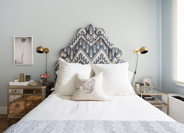Marvelous Chic Blue Bedroom Features A Pale Blue Wall Lined With A Blue Ikat  Headboard With Brass Nailhead Trim On Bed Dressed In White And Blue Bedding  Flanked By ...