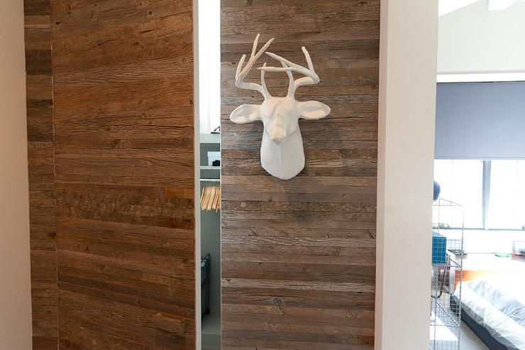Boyu002639s Bedroom Features A Closet Boasting Plank Doors Lined With Faux Stag Head  R