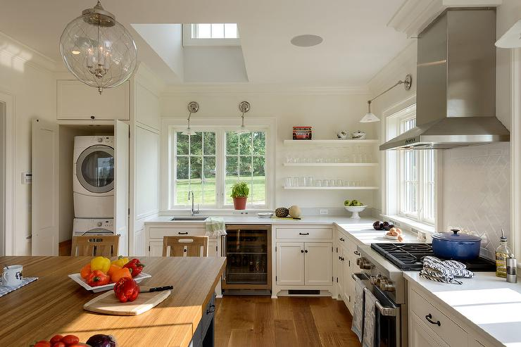 Kitchen With Hidden Stacked Washer And Dryer Cottage