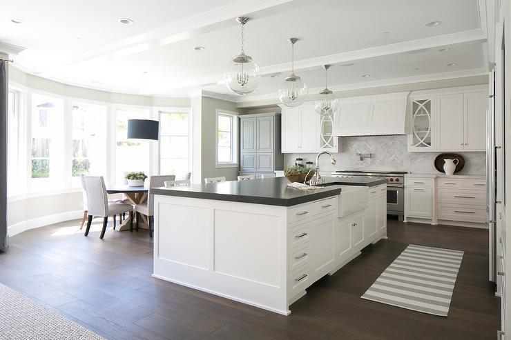 White Center Island With Black Countertop Transitional
