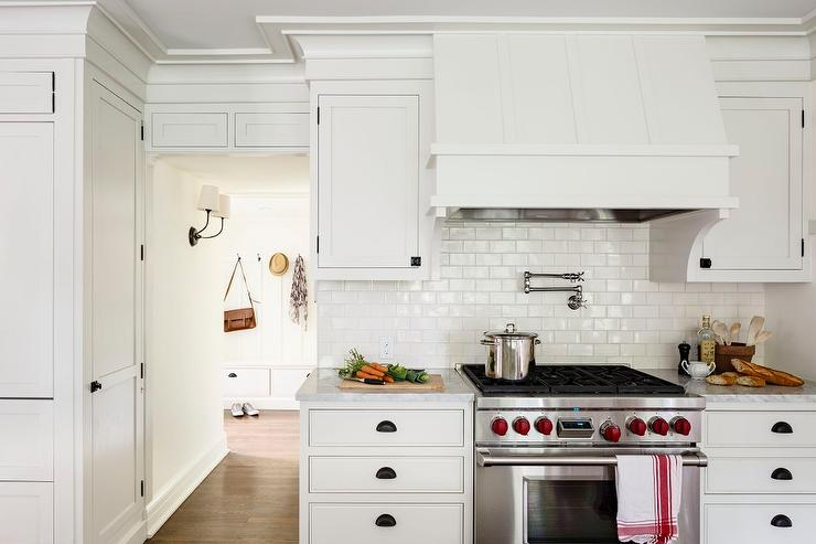 kitchen with white glazed mini subway tile backsplash