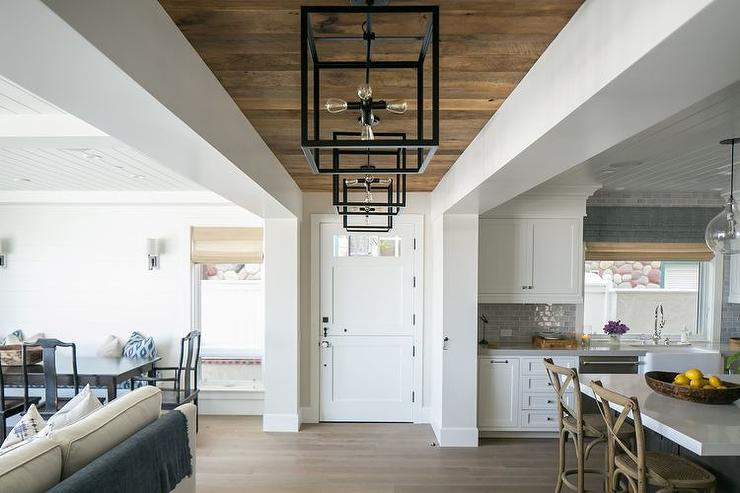 Foyer Hallway With Plank Ceiling And Iron Lanterns