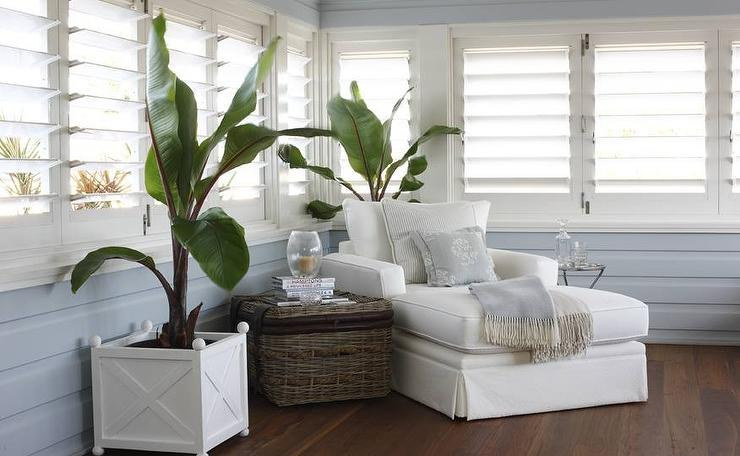 Sunroom with plantation shutters cottage living room for Decorating with plantation shutters
