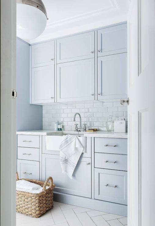 Blue Laundry Room Cabinets With White Subway Tiles