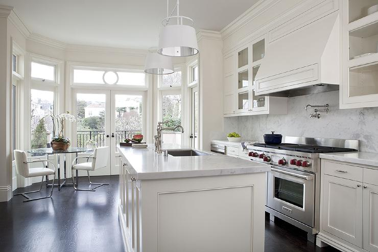 white kitchen cabinets with white marble countertops