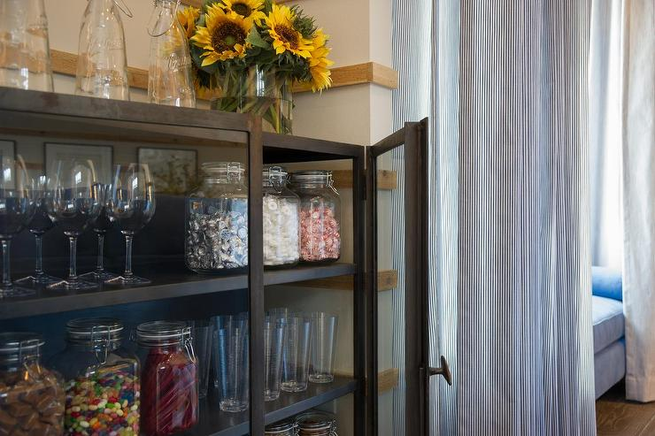 Family TV Room With Candy Snack Cabinet
