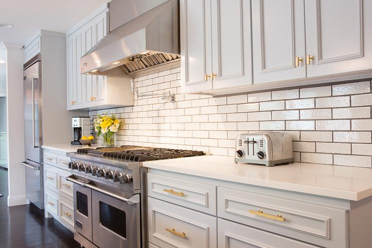 Grey Kitchen Cabinets Gold Hardware light gray kitchen cabinets with gold hardware - transitional