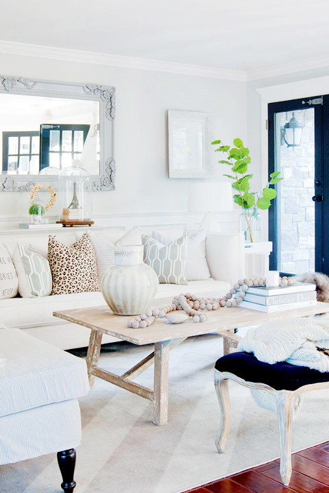 White Low Sofa With Gray Suzani Pillows Transitional