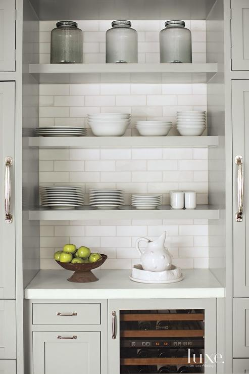 Stacked gray floating kitchen shelves transitional kitchen Floating shelf ideas for kitchen