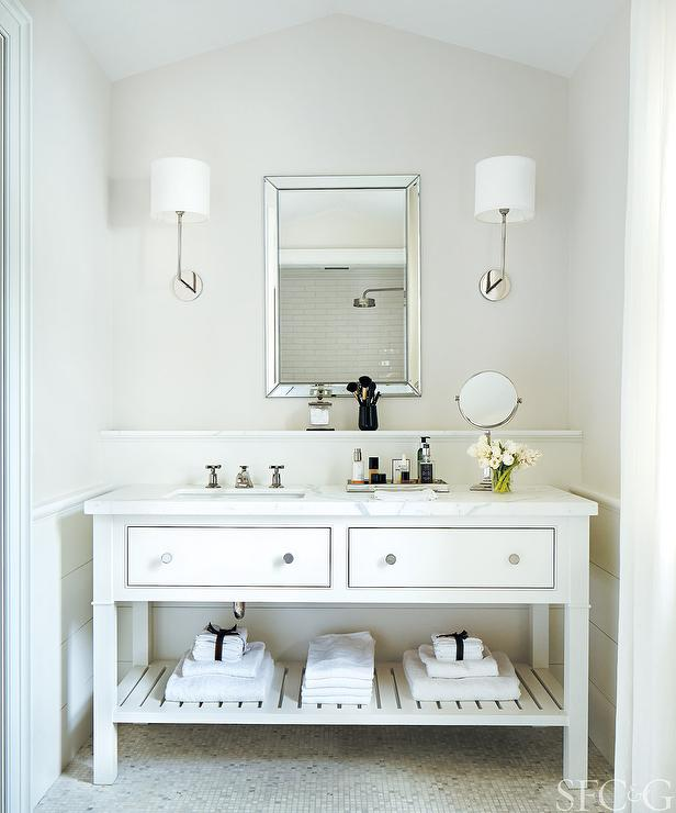 Chic Cottage Bathroom Features Upper Walls Painted Light Grey And Lower Clad In Horizontal Shiplap Wainscoting Lined With A White Washstand Shelf