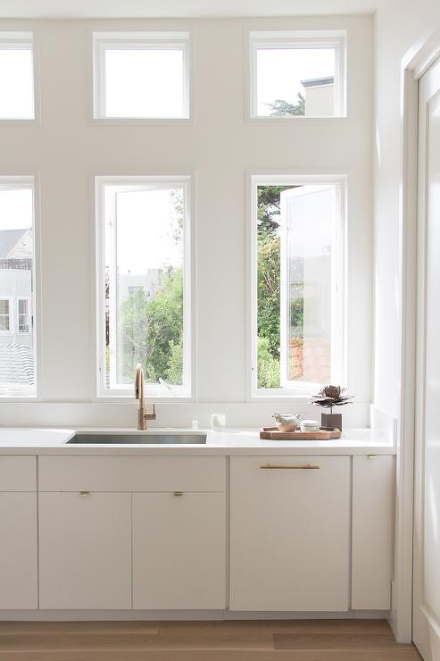 Windows In Lieu Of Upper Cabinets Over A White Flat Front Cabinets