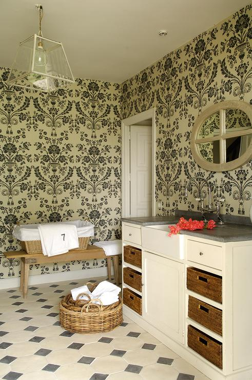 'view full size' from the web at 'https://cdn.decorpad.com/photos/2015/05/24/cream-and-black-laundry-room-cream-cabinets-concrete-countertop.jpg'