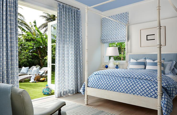 Blue bedroom features a blue ceiling over an ivory canopy bed accented with  a blue headboard dressed in a blue duvet and blue striped pillows next to  an. Ivory And Blue Curtains Design Ideas