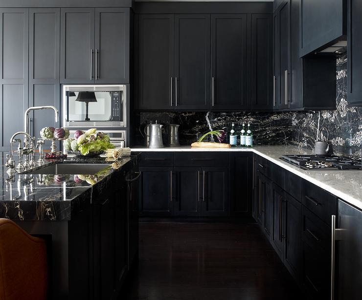 Noir kitchen cabinets with white marble countertops for Kitchen black cupboards