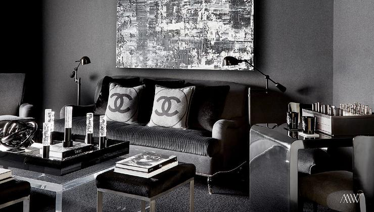 Bold Black Living Room Features A Black Wall Lined With A Black And White  Abstract Art Piece Over A Black Roll Arm Sofa On Caster Legs Adorned With  Grey And ...