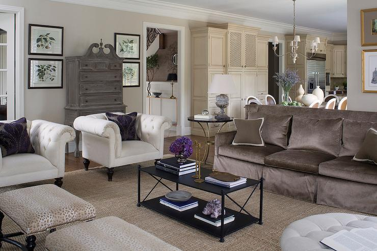 brown sofa with white accent chairs transitional living room