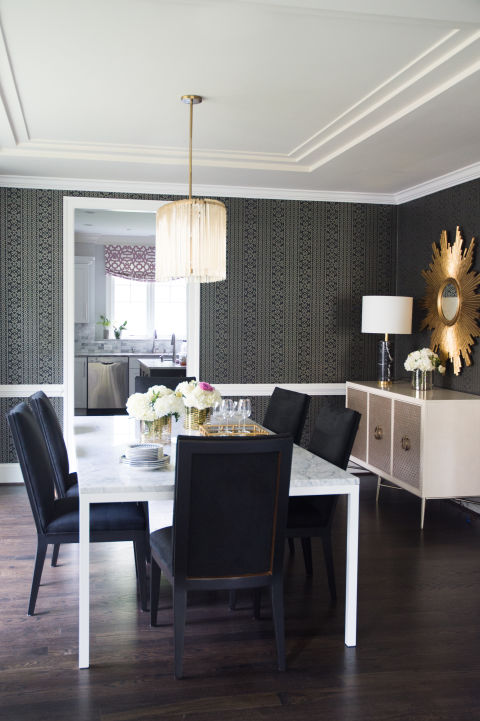 Chic Dining Room Features Black And Gray Print Wallpaper Accented With A White Chair Rail Lined Metallic Buffet Cabinet Under Gold Sunburst Mirror