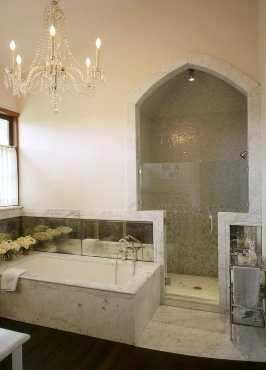 Tub With Antiqued Mirrored Backsplash Transitional Bathroom