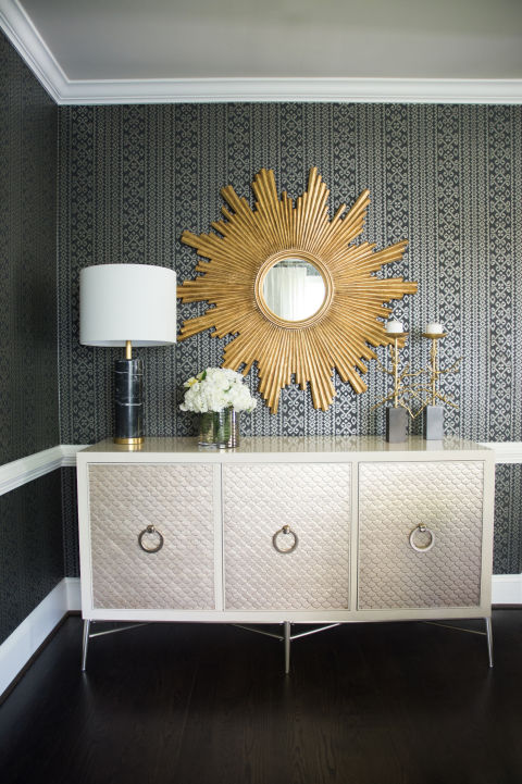 Chic Dining Room Features Black And Gray Print Wallpaper Accented With A White Chair Rail Lined Shimmering Metallic Buffet Cabinet Topped