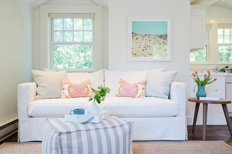 White Sofa With Orange Pillows