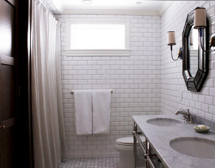 Bathroom With White Beveled Subway Tiles