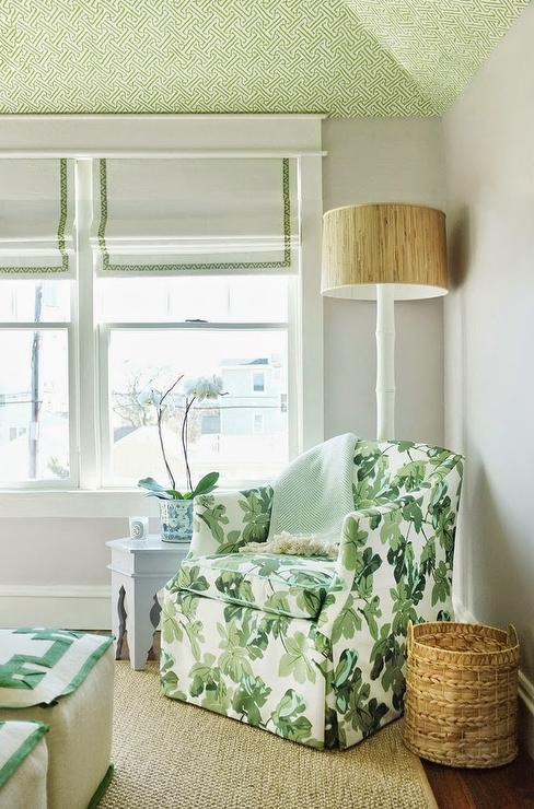 amazing bedroom reading corner boasts a green wallpapered vaulted ceiling over a green chair upholstered in peter dunham fig fabric draped with a blue