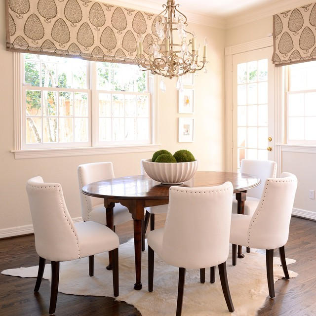 Oval DiningTable With White Dining Chairs Transitional Dining Room - Cowhide rug dining room
