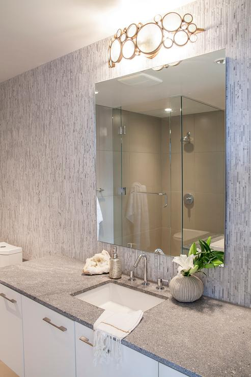 bathroom with vertical marble tile backsplash