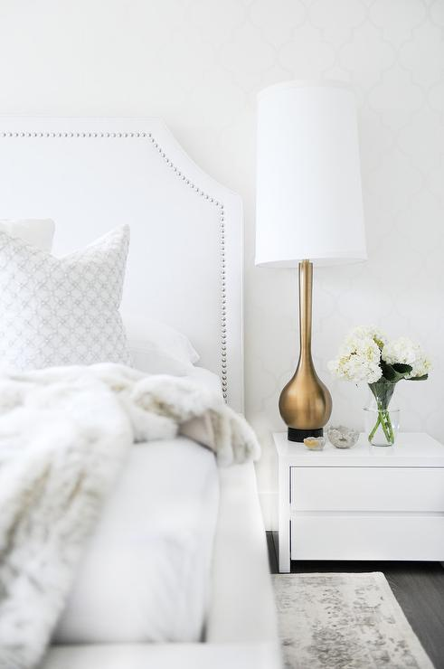white bedroom with gold accents transitional bedroom