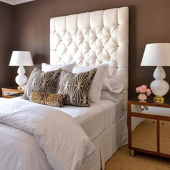 white and brown bedroom features walls painted chocolate brown lined