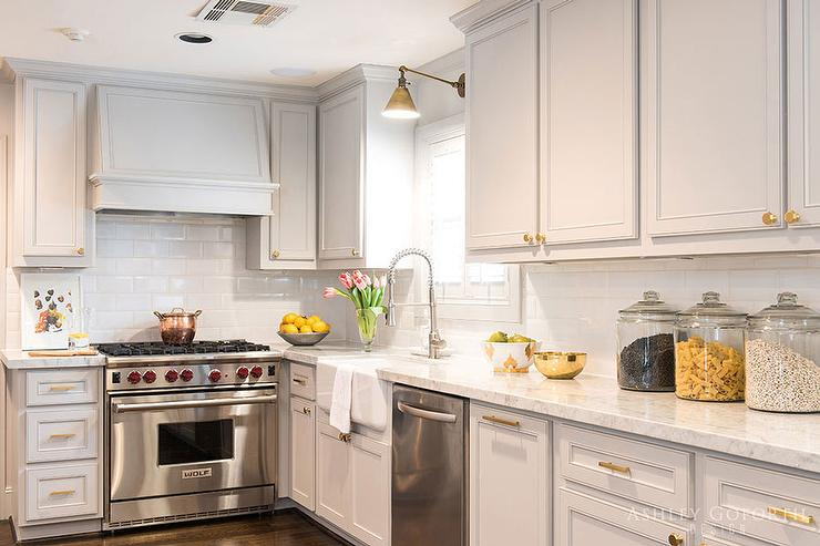 grey kitchen cabinets brass hardware light gray hood l shaped kitchen