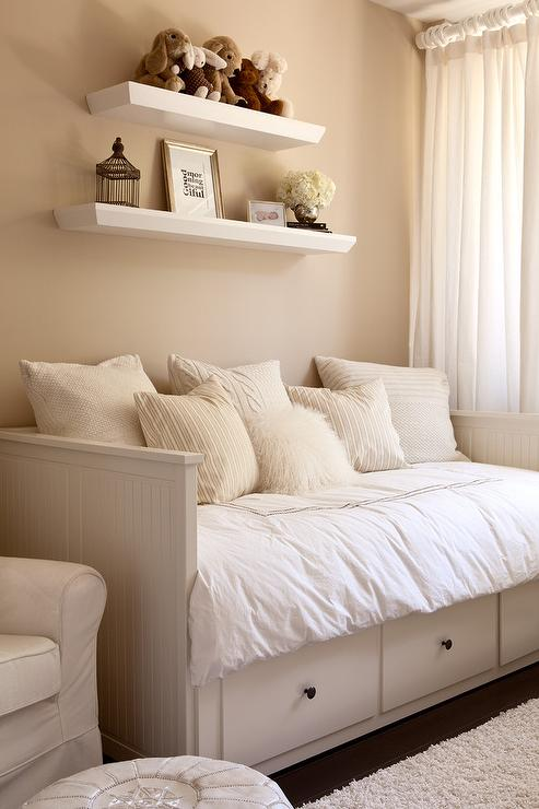 Gender neutral nursery features walls painted tan  Benjamin Moore  Everlasting  lined with stacked shelves over a white beadboard daybed  Ikea  Hemnes Daybed   Gender Neutral Nursery Design Ideas. Paint Colors For Gender Neutral Nursery. Home Design Ideas