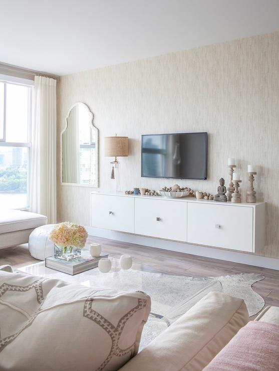 Superior Gorgeous Living Room Features A White Lacquer Media Cabinet Topped With  River Rocks, Buddha And A Clear Glass Tassel Lamp Under A Flatscreen TV.
