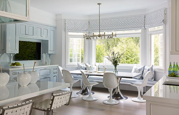Blue Breakfast Nook Features A Built In Bench Window Seat Topped With Cushion And Pillows Under Bay Dressed Geometric Roman